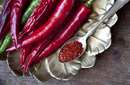 Fresh and grounded chili peppers in red and green Stock Photo - 10903258
