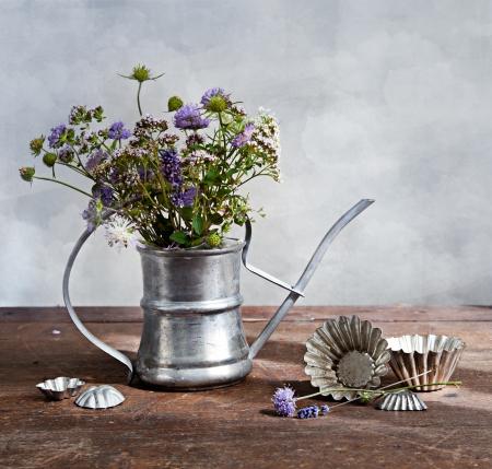 Bouquet of wild flowers in old metal ewer Standard-Bild