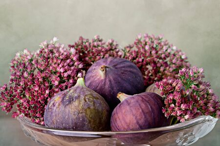 Fresh Fig fruits in decorative glass bowl photo