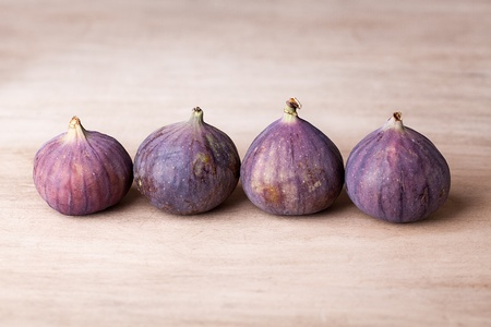 Fresh fig fruits arranged on wooden table Stock Photo - 11299309