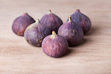 Fresh fig fruits arranged on wooden table photo