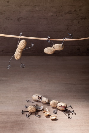 failing: Miniature with Peanut People trying to hold their balance and grasping for a straw