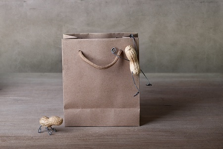 Miniature with Peanut People Climbing into Shopping bag