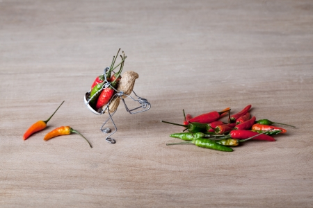 tinker bell: Miniature with peanut worker carrying red and green chili peppers Stock Photo