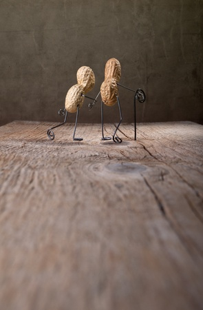 Miniature with old couple walking together photo