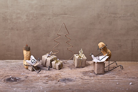 Miniature with Peanut People on Christmas unpacking their presents Stock Photo - 11888826