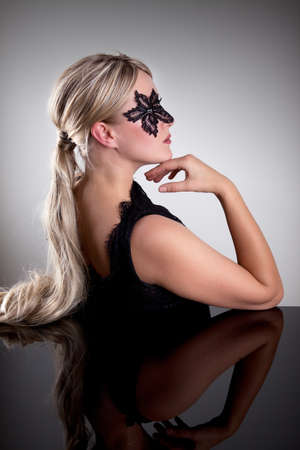Woman with Lace Mask costumed for Halloween Party photo