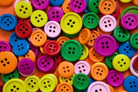 Heap of buttons in many color variations photo