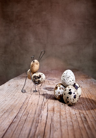 tinkered: Peanut Easter Bunnies preparing eggs with some small mishaps Stock Photo