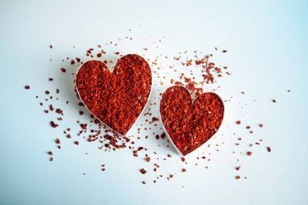 grounded: Two hearts filled with grounded red chili flakes