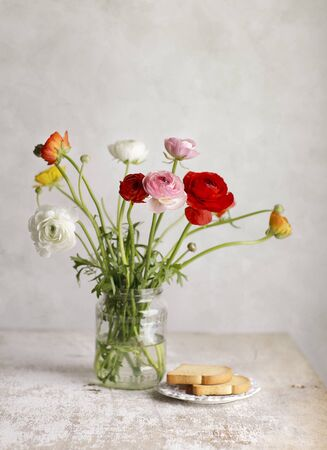 Studio Still Life with beautiful Persian Buttercup Flowers photo