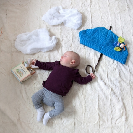 4 Month old Baby girl flying with cloth umbrella