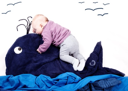 4 Month old Baby girl riding on Whale Stock Photo - 13622339