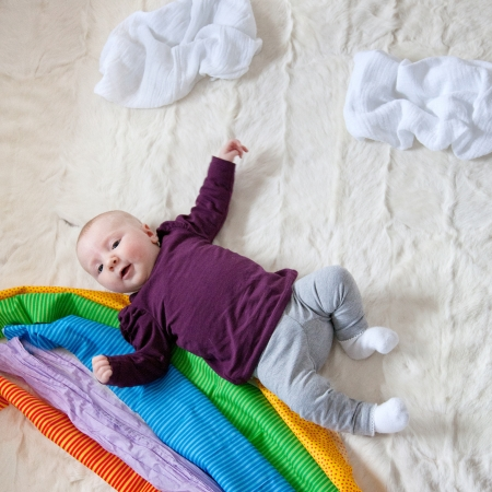 4 Month old Baby girl and colorful cloth rainbow Stock Photo - 13622345