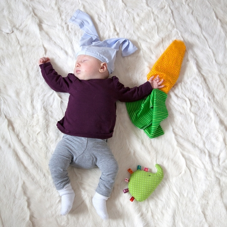 4 Month old Baby girl dressed as rabbit with carrots photo