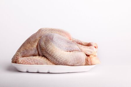 plucked: Raw whole plucked chicken ready for cooking on a plastic styrofoam disposable punnet Stock Photo