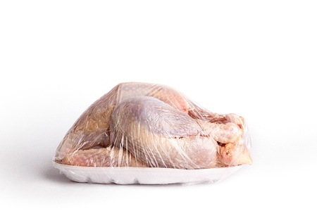 Raw whole plucked chicken on a disposable styrofoam punnet in plastic wrapping Stock Photo - 13725165