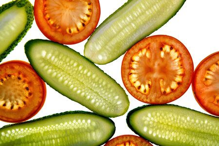 Slices of fresh cucumber and tomato on white background photo