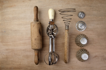 Old Vintage wooden rolling Pin with hand-cranked mixer and egg beater Stock Photo