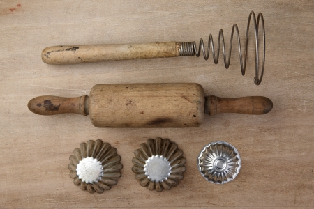 Old Vintage wooden rolling Pin with cokking forms and egg beater photo