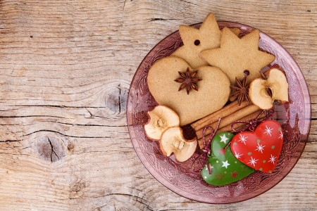 Christmas theme Still-Life with Gingerbread and Cinnamon Star Cookies and Spices on glass plate photo