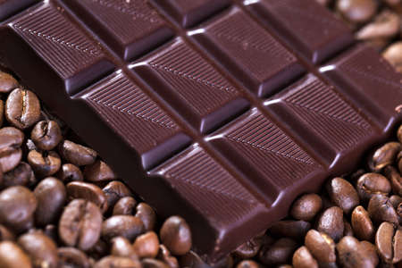 Fresh roasted coffee beans and bar of brown chocolate Stock Photo - 17322891