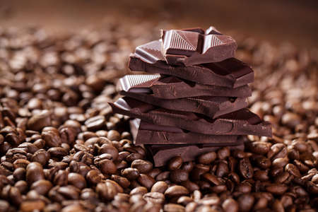 Fresh roasted coffee beans and stack of brown chocolate Stock Photo - 17322898