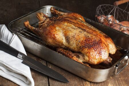 duck: Crispy roasted Barbery Duck in in roasting pan ready for serving