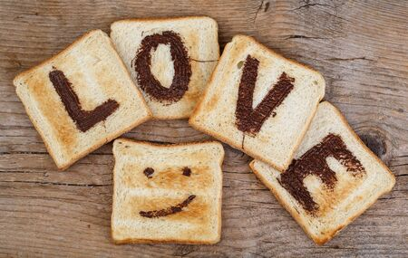 spread the word: Toast Bread with the Word LOVE painted with hazelnut chocolate spread and smiling face