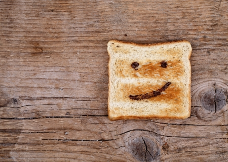 painted face: Toast Bread with happy face painted with hazelnut chocolate spread