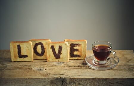 spread the word: Toast Bread with the Word LOVE painted with hazelnut chocolate spread and a cup of tea
