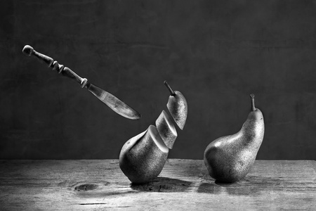 disjoint: Fresh Pears being chased and cut to slices by flying knife