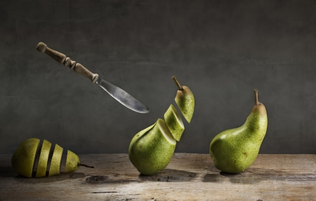 futile: Fresh Pears being chased and cut to slices by flying knife