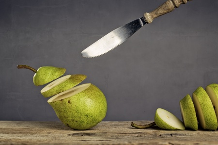 levitate: Fresh Pears being chased and cut to slices by flying knife