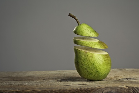 disjoint: Fresh Pears cut to slices on wooden board Stock Photo
