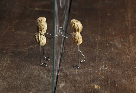 apart: Couple of Peanut People being kept apart by a glass wall