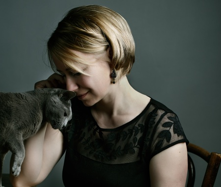 Portrait of an adult Woman with her purebred Russian Blue Cat Stock Photo - 19972623