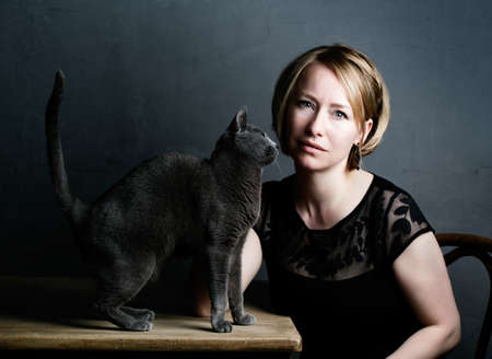 Portrait of an adult Woman with her purebred Russian Blue Cat Stock Photo - 19972628