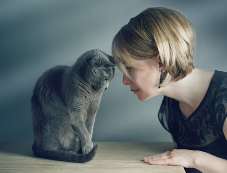 Portrait of an adult Woman with her purebred Russian Blue Cat photo