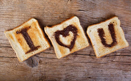 I Love You painted with hazelnut cream on white toast bread photo