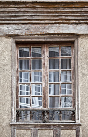 dinan: Old antique window on historic house in the city of Dinan France