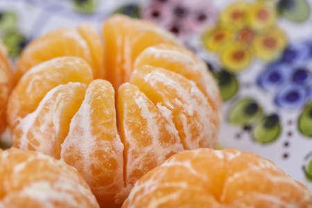 stoneware: Fresh Peeled Clementines on Stoneware Plate
