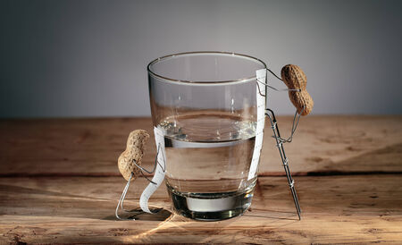 half full: Simple Things Peanuts Miniature - Half Empty or Half Full Stock Photo