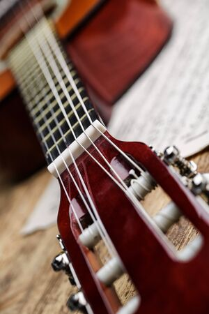 nylon string: Classical nylon string guitar with sheet music Stock Photo