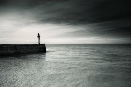 normandy: Coast and Lighthouse at Fecamp in Normandy France in  Autumn