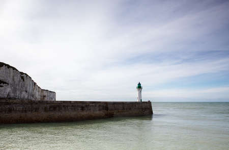 pharos: Coast and Lighthouse at Fecamp in Normandy France in  Autumn
