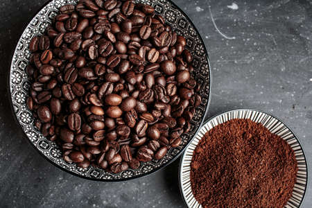 Fresh whole Coffee Beans and Ground Coffee on plate