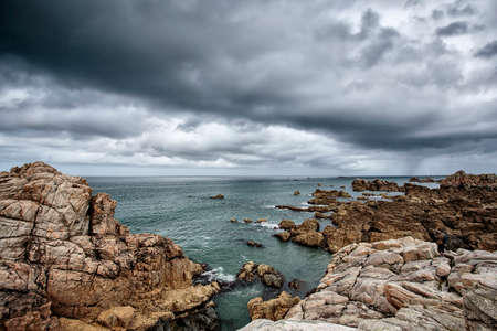 cotes d armor: Beach and Stones at the pink Granite Coast in the Departement Cotes d Armor in Brittany France