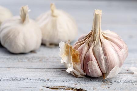 Fresh whole Garlic Bulb on wooden board