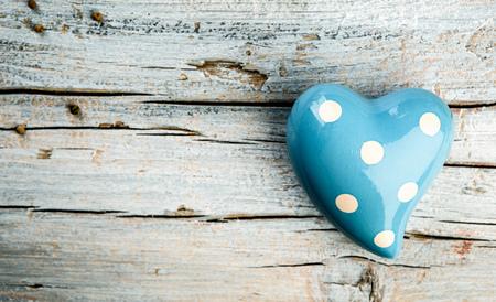 Blue Heart on wooden board